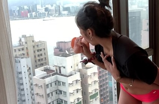 NAUGHTY DESI COLLEGE TEEN RIDES DILDO AGAINST HONG KONG SKYSCRAPER WINDOW