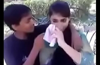 Indian teen kissing together with beyond hope boobs connected with public